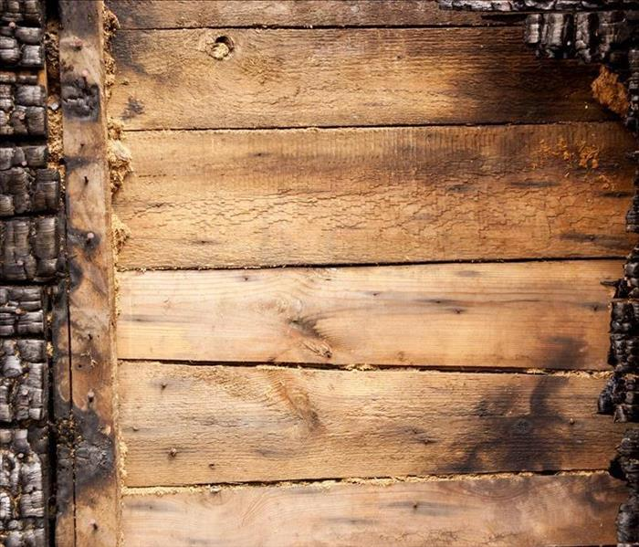Charred wood on a home.