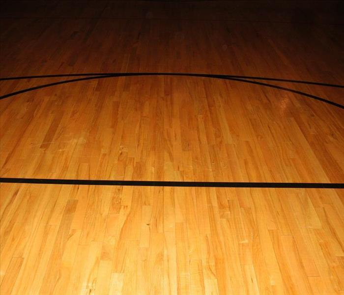 Basketball Court Hardwood Flooring from behind the backboard view