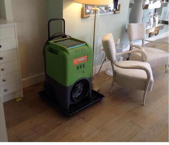 One of our green machines sitting in a room after water damage struck