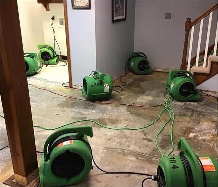 Our air movers drying the floors in this home after a water damage disaster